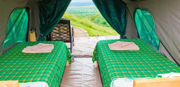 Voyage sur-mesure, Lodge de tentes avec une belle vue sur le parc